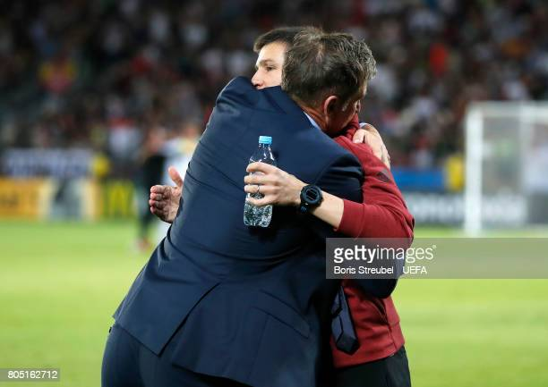 Stefan Kuntz coach of Germany hugs Albert Celades of Spain following the UEFA European Under21 Championship Final match between Germany and Spain at...