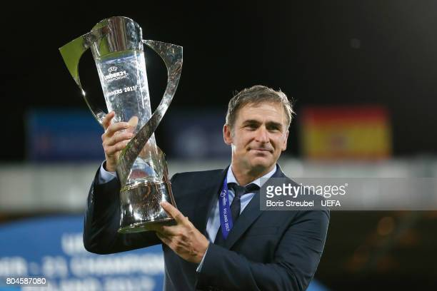 Stefan Kuntz coach of Germany poses with the trophy after the UEFA European Under21 Championship Final between Germany and Spain at Krakow Stadium on...