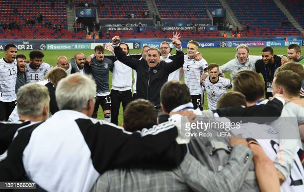 Stefan Kuntz, Head Coach of Germany celebrates their side's victory with his players after the 2021 UEFA European Under-21 Championship Semi-finals...