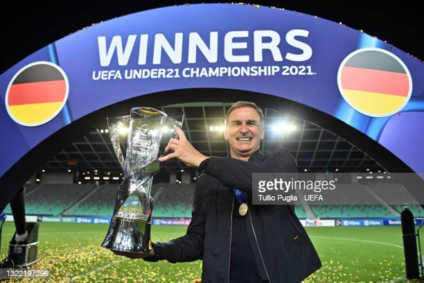 Stefan Kuntz, Head Coach of Germany poses with the UEFA European Under-21 Championship trophy following victory in the 2021 UEFA European Under-21...