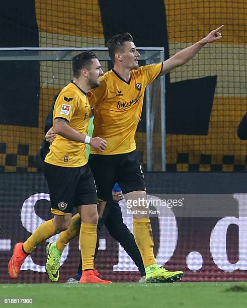 Stefan Kutschke of Dresden jubilates with team mate Pascal Testroet after scoring the fived goal during the Second Bundesliga match between SG Dynamo...