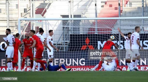 Stefan Kutschke of Ingolstadt scores his teams first goal during the 2. Bundesliga playoff second leg match between FC Ingolstadt and 1. FC Nürnberg...