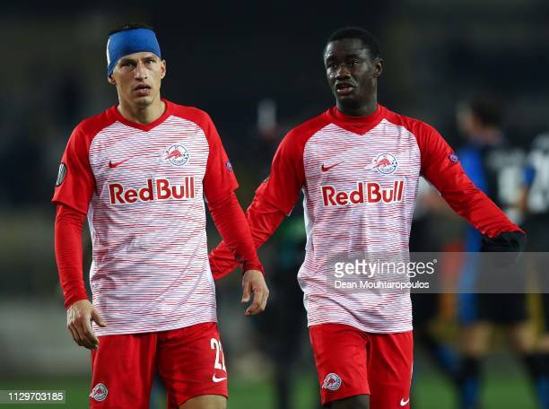 Stefan Lainer and Diadie Samassekou of FC Salzburg thank the supporters at the end of the UEFA Europa League Round of 32 First Leg match between Club...