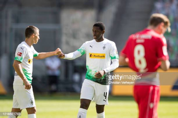 Stefan Lainer and Mamadou Doucoure of Borussia Moenchengladbach in action during the Bundesliga match between Borussia Moenchengladbach and 1 FC...