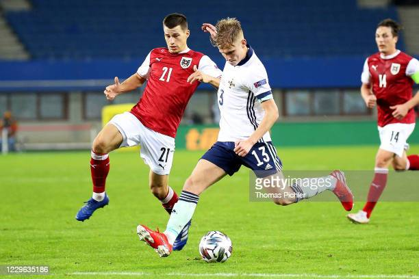 Stefan Lainer of Austria and Alistair Edward McCann of Northern Ireland during the UEFA Nations League between Austria and Northern Ireland at the...