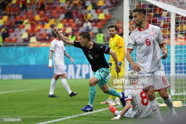 Stefan Lainer of Austria celebrates after scoring their side's first goal during the UEFA Euro 2020 Championship Group C match between Austria and...