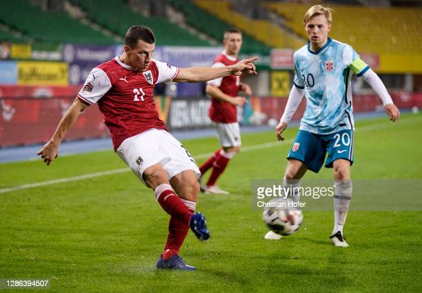 Stefan Lainer of Austria crosses the ball as Mats Moeller Daehli of Norway looks onduring the UEFA Nations League group stage match between Austria...