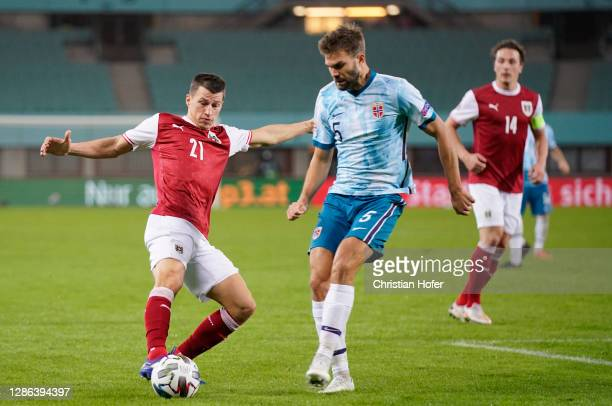 Stefan Lainer of Austria is challenged by Joergen Skjelvik of Norway during the UEFA Nations League group stage match between Austria and Norway at...