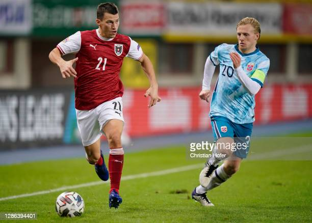 Stefan Lainer of Austria is challenged by Mats Moeller Daehli of Norway during the UEFA Nations League group stage match between Austria and Norway...