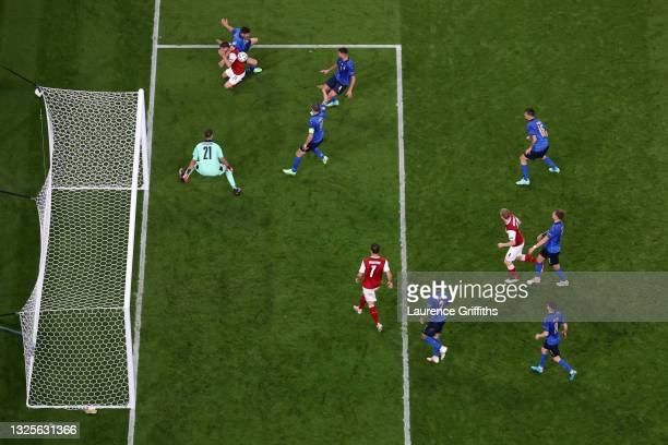 Stefan Lainer of Austria is challenged by Matteo Pessina of Italy during the UEFA Euro 2020 Championship Round of 16 match between Italy and Austria...