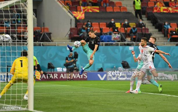 Stefan Lainer of Austria scores their side's first goal past Stole Dimitrievski of North Macedonia during the UEFA Euro 2020 Championship Group C...