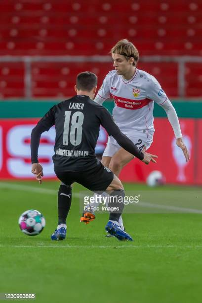 Stefan Lainer of Borussia Moenchengladbach and Borna Sosa of VfB Stuttgart battle for the ball during the DFB Cup Round of Sixteen match between VfB...