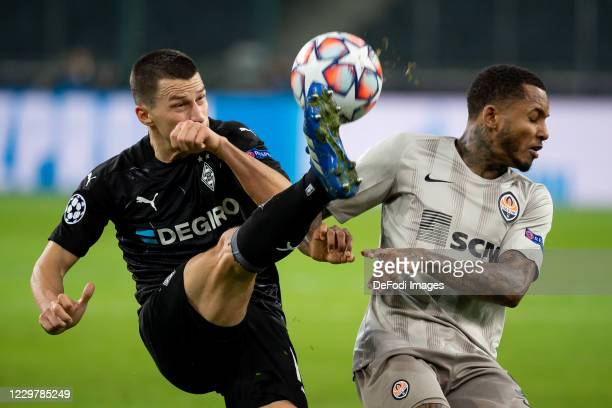 Stefan Lainer of Borussia Moenchengladbach and Fernando of Shakhtar Donetsk battle for the ball during the UEFA Champions League Group B stage match...