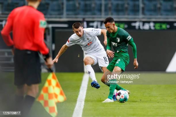 Stefan Lainer of Borussia Moenchengladbach and Iago Amaral Borduchi battle for the ball during the Bundesliga match between Borussia Moenchengladbach...