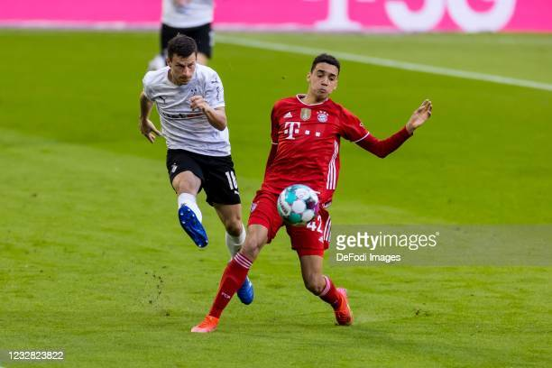 Stefan Lainer of Borussia Moenchengladbach and Jamal Musiala of Bayern Munich battle for the ball during the Bundesliga match between FC Bayern...