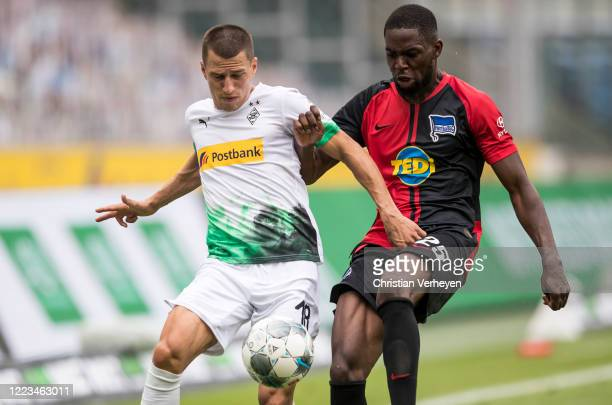 Stefan Lainer of Borussia Moenchengladbach and Jordan Torunarigha of Hertha BSC in action during the Bundesliga match between Borussia...