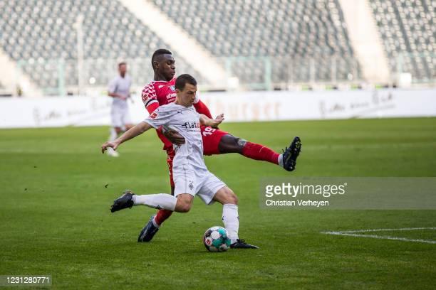 Stefan Lainer of Borussia Moenchengladbach and Moussa Niakhaté of 1. FSV Mainz 05 battle for the ball during the Bundesliga match between Borussia...