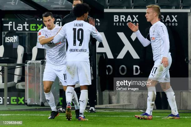 Stefan Lainer of Borussia Moenchengladbach and Valentino Lazaro of Borussia Moenchengladbach substitutes during the Bundesliga match between Borussia...