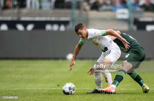 Stefan Lainer of Borussia Moenchengladbach and Xaver Schlager of VfL Wolfsburg in action during the Bundesliga match between Borussia...