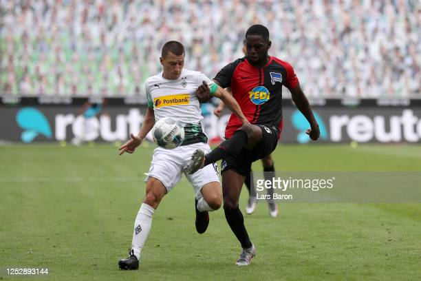 Stefan Lainer of Borussia Moenchengladbach battles for possession with Jordan Torunarigha of Hertha BSC during the Bundesliga match between Borussia...