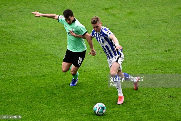 Stefan Lainer of Borussia Moenchengladbach battles for possession with Maximilian Mittelstaedt of Hertha Berlin during the Bundesliga match between...