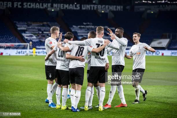 Stefan Lainer of Borussia Moenchengladbach celebrate with team mate Jonas Hofmann after he score his teams second goal during the Bundesliga match...