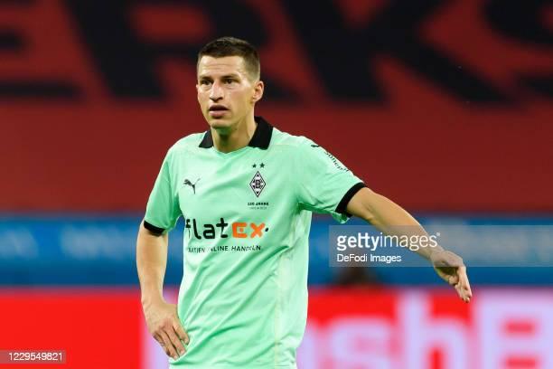Stefan Lainer of Borussia Moenchengladbach gestures during the Bundesliga match between Bayer 04 Leverkusen and Borussia Moenchengladbach at BayArena...