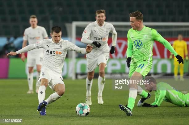 Stefan Lainer of Borussia Moenchengladbach is put under pressure by Yannick Gerhardt of VfL Wolfsburg during the Bundesliga match between VfL...