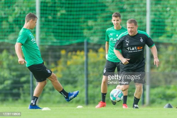 Stefan Lainer of Borussia Moenchengladbach Rocco Reitz of Borussia Moenchengladbach and Sporting director Max Eberl of Borussia Moenchengladbach...