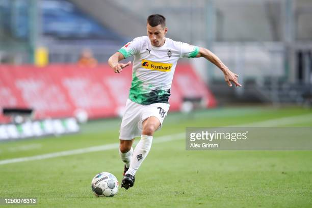 Stefan Lainer of Borussia Moenchengladbach runs with the ball during the Bundesliga match between Borussia Moenchengladbach and VfL Wolfsburg at...