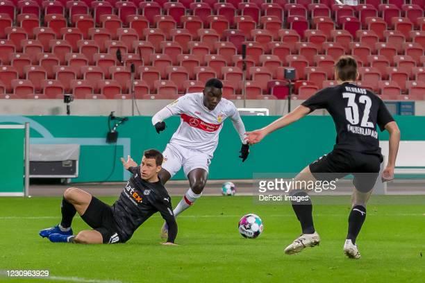Stefan Lainer of Borussia Moenchengladbach, Silas Wamangituka of VfB Stuttgart and Florian Neuhaus of Borussia Moenchengladbach battle for the ball...