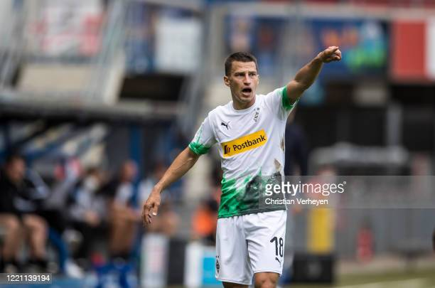 Stefan Lainer of Borussia Monchengladbach gives instructions during the Bundesliga match between SC Paderborn and Borussia Moenchengladbach at...