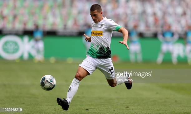 Stefan Lainer of Moenchengladbach runs with the ball during the Bundesliga match between Borussia Moenchengladbach and Hertha BSC at BorussiaPark on...