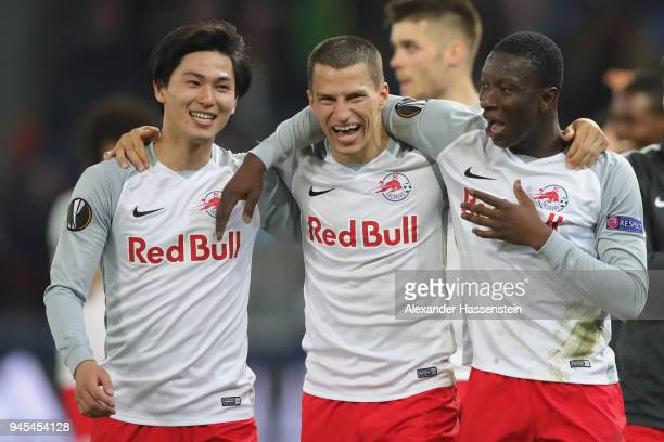 Stefan Lainer of Salzburg celebrates victory with his team mates Takumi Minamino and Amadou Haidara after winning the UEFA Europa League quarter...