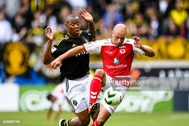 Stefan Larsson of Kalmar FF and Carlos Strandberg of AIK competes for the ball during the allsvenskan match between Kalmar FF and AIK at Guldfageln...