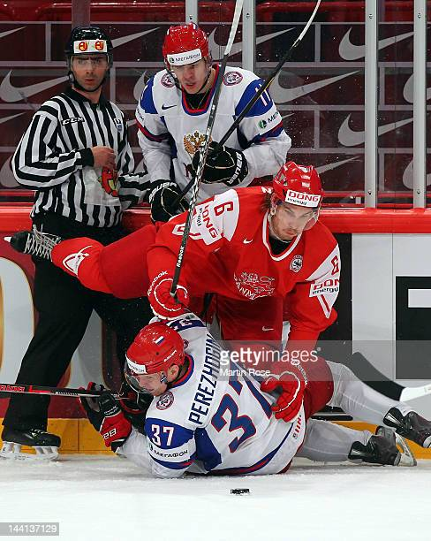 Stefan Lassen of Denmark and Alexander Perezhogin of Russia battle for the puck during the IIHF World Championship group S match between Denmark and...