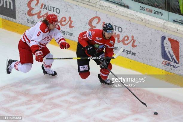 Stefan Lassen of Denmark and Michael Raffl of Austria during the Austria v Denmark - Ice Hockey International Friendly at Erste Bank Arena on May 5,...