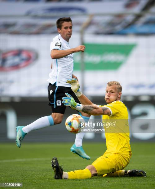Stefan Lex of 1860 Muenchen in action with Nico Mantl of Unterhaching during the 3 Liga match between TSV 1860 Muenchen and SpVgg Unterhaching at...