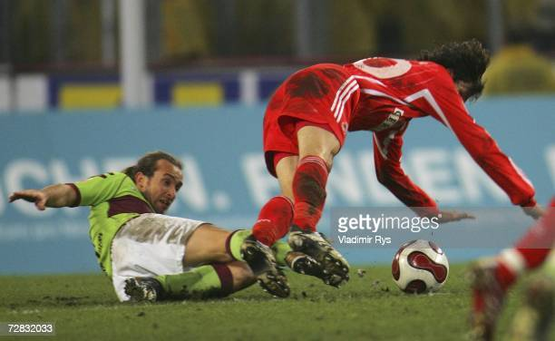 Stefan Lexa of Kaiserslautern tackles Thomas Broich of Cologne during the Second Bundesliga match between 1.FC Cologne and 1.FC Kaiserslautern at the...