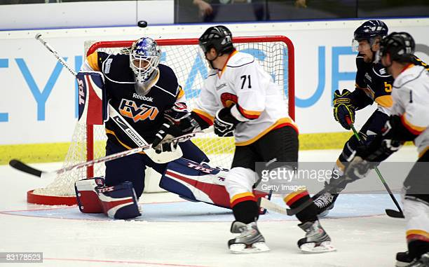 Stefan Liv of Jonkoping get the puck on his head during the IIHF Champions Hockey League match between HV71 Joenkoeping and SC Bern on October 8,...