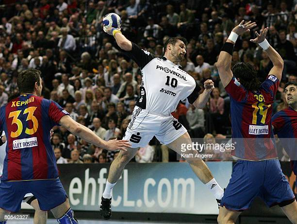 Stefan Loevgren of Kiel jumps to shoot during the EHF Champions League semi final match between THW Kiel and Barcelona at the Ostseehalle on April 6...