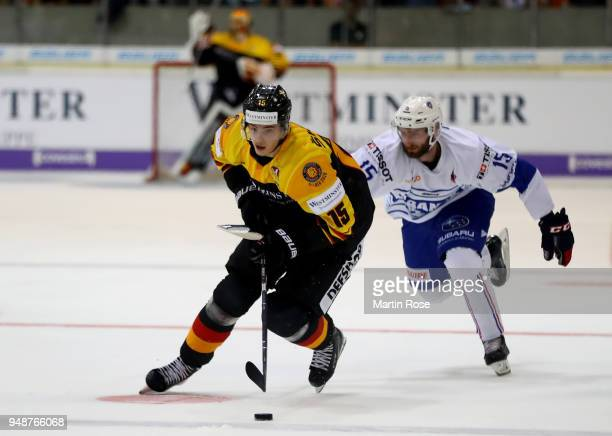 Stefan Loibl of Germany and Maurin Bouvet of France battle for the puck during the Icehockey International Friendly match between Germany and France...
