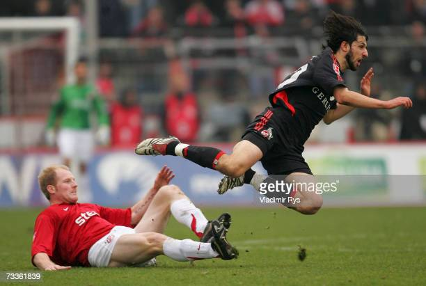 Stefan Lorenz of Essen fouls Thomas Broich of Cologne during the Second Bundesliga match between Rot Weiss Essen and 1FC Cologne at the GeorgMelches...
