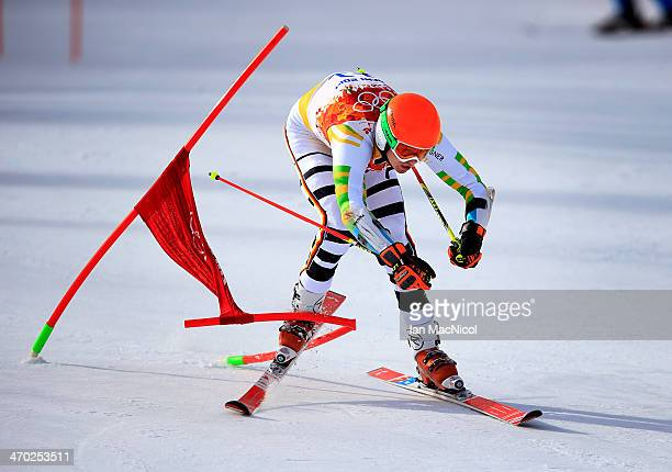 Stefan Luitz of Germany straddles the last gate during round one of the Men's Giant Slalom on Day 12 of the Sochi 2014 Winter Olympics at Rosa Khutor...