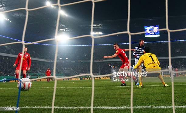 Stefan Maierhofer of Duisburg heads his teams first goal past goalkeeper Thorsten Kirschbaum of Cottbus during the DFB Cup semi final match between...