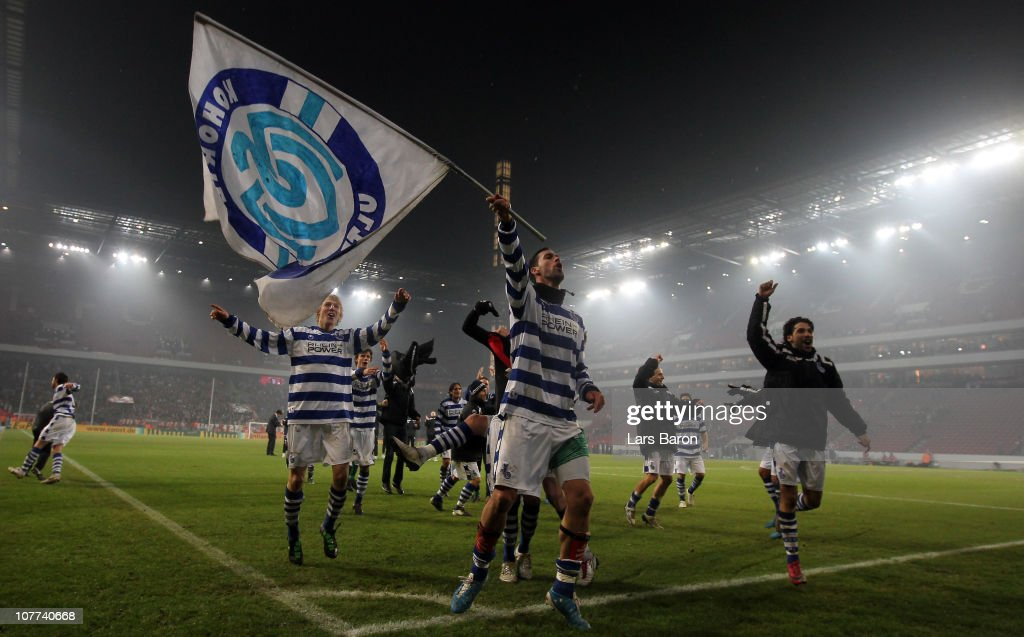 Stefan Maierhofer of Duisburg, who scored the first goal, celebrates with his team mates after winning the DFB Cup round of sixteen match between 1. FC Koeln and MSV Duisburg at RheinEnergie Stadium on December 22, 2010 in Cologne, Germany.