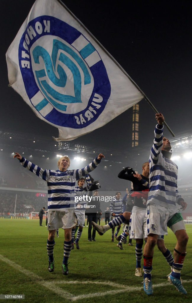 Stefan Maierhofer of Duisburg, who scored the first goal, celebrates with Julian Koch and other team mates after winning the DFB Cup round of sixteen match between 1. FC Koeln and MSV Duisburg at RheinEnergie Stadium on December 22, 2010 in Cologne, Germany.
