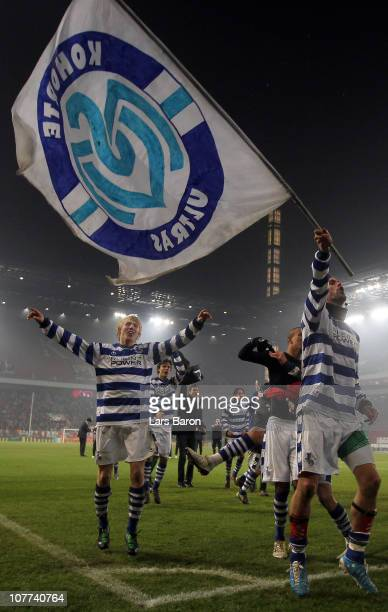 Stefan Maierhofer of Duisburg, who scored the first goal, celebrates with Julian Koch and other team mates after winning the DFB Cup round of sixteen...