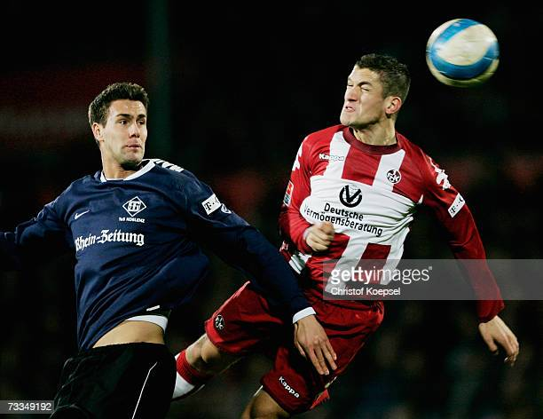 Stefan Maierhofer of Koblenz and Ismael Bouzid of Lautern go up for a header during the Second Bundesliga match between TuS Koblenz and 1.FC...