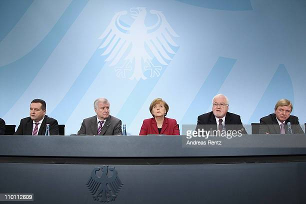 Stefan Mappus BadenWuerttemberg's state governor Bavarian Governor Horst Seehofer German Chancellor Angela Merkel Peter Harry Carstensen Governor of...
